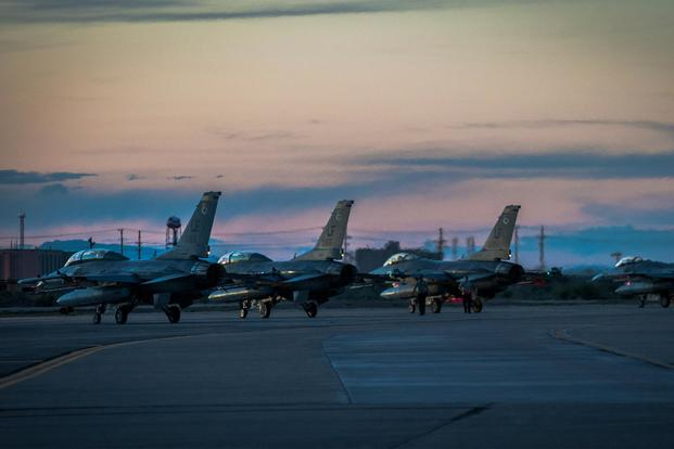 F-16 Fighting Falcons sit on the runway at Holloman Air Force Base. (Air Force Photo)