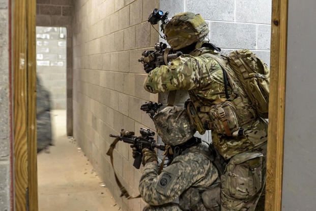 Paratroopers assigned to Alpha Company, 1st Battalion, 508th Parachute Infantry Regiment provide security in a hallway during an urban air assault exercise at Fort A.P. Hill, Va., on March 20. (US Army photo/John Lytle)