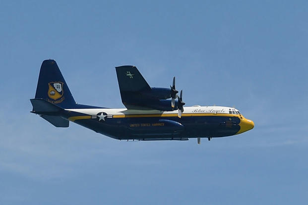 The U.S. Navy Flight Demonstration Squadron, the Blue Angels' C-130, Fat Albert, passes in front of the crowd at the 2018 Pensacola Beach Air Show, July 14, 2018. (U.S. Navy photo/Jess Gray)