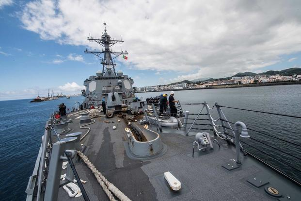 Sailors man the rails of the guided-missile destroyer USS Jason Dunham (DDG 109) as the ship departs from Ponta Delgada, Azores. (U.S. Navy/Mass Communication Specialist 3rd Class Jonathan Clay)