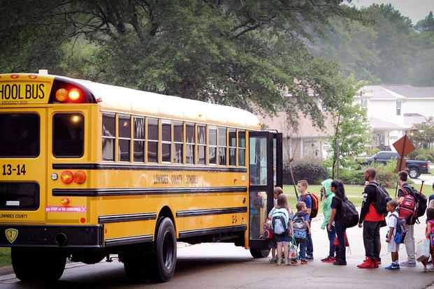 Children from the Magnolia Village housing area on Columbus Air Force Base, Mississippi, board the school bus Aug 7, 2017, on their way to school. (U.S. Air Force photo/Savannah G Stephens)