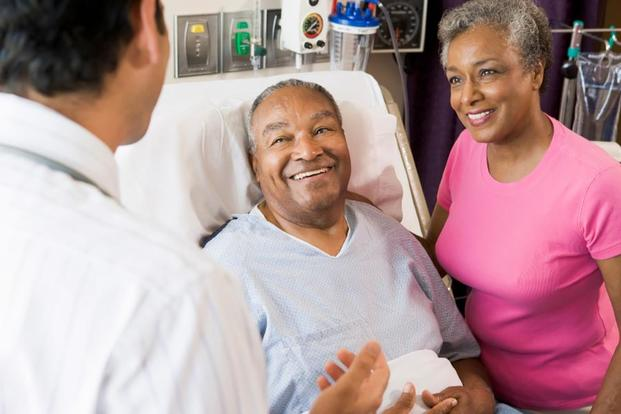 A veteran and his caregiver speak to a doctor. (Image: va.gov)