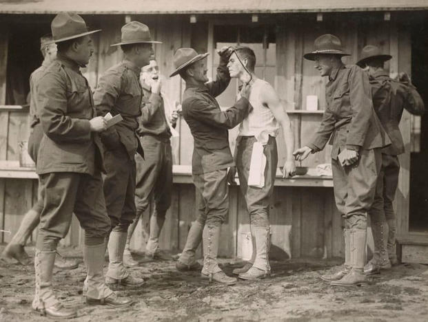 "A soldier gets some assistance with shaving his ""strong"" beard at the Plattsburg, New York, training camp. Note that in World War I, the brown rounds weren't restricted to training cadre. (Photo: National Archives and Records Administration)"