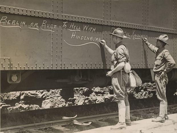 Engineers ready to ship out write motivational messages on the side of their train car just before they leave the Atlanta, Georgia, area for France. (Photo: National Archives and Records Administration)
