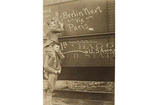 New York recruits heading to training write messages on the sides of their train. (Photo: National Archives and Records Administration)