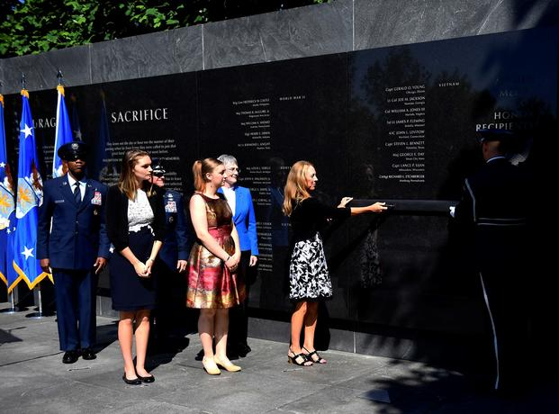 Valerie Nessel, spouse of U.S. Air Force Tech. Sgt. John Chapman, and his daughters Brianna and Madison Chapman, unveil his name during a ceremony at the Air Force Memorial, in Arlington, Va., Aug. 24, 2018. Sergeant Chapman was posthumously awarded the Medal of Honor for actions on Takur Ghar mountain in Afghanistan on March 4, 2002. (Rusty Frank/Air Force)