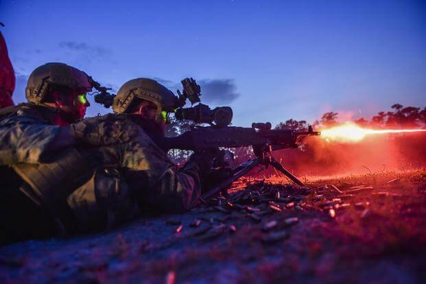 Marine Special Operations School Individual Training Course students fire an M249 squad automatic weapon during night-fire training April 13, 2017, at Camp Lejeune. (U.S. Air Force/Senior Airman Ryan Conroy)