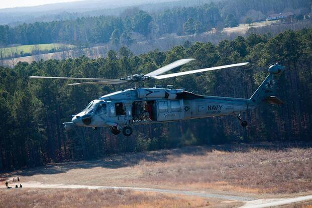 U.S. Soldiers with the 55th Signal Company (Combat Camera) travel aboard an MH-60 Seahawk helicopter to gather aerial photographs during Exercise Southern Raider 13 at Fort Pickett, Va., March 4, 2013. (U.S. Army/Sgt. Mikki L. Sprenkle)