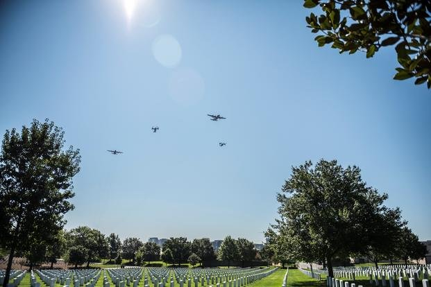 A flyover known as the Missing Man Formation passes over Section 67 and 68 at Arlington National Cemetery, Arlington, Virginia, August 24, 2018. The flyover was part of a memorial ceremony for Medal of Honor recipient U.S. Air Force Tech. Sgt. John Chapman at the U.S. Air Force Memorial in Arlington, Virginia. (Elizabeth Fraser/U.S. Army)