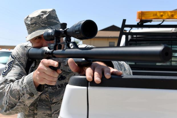 U.S. Air Force Master Sgt. Brett Pate, 317th Airlift Wing flight safety noncommissioned officer, aims an airsoft rifle into a field at Dyess Air Force Base, Texas, May 15, 2018. (U.S. Air Force/Airman 1st Class Mercedes Porter)