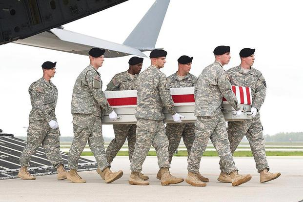 Staff Sgt. Michael Simpson's casket is offloaded from a plane in 2013. Courtesy of Krista Simpson Anderson