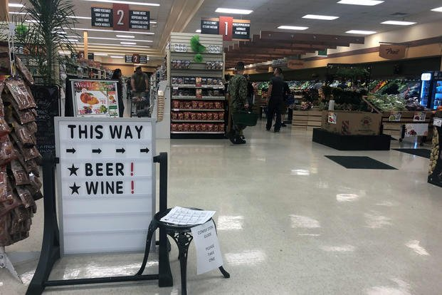 A sign at Port Huememe, California points shoppers to the store's beer and wine selection. (Photo: Military.com)