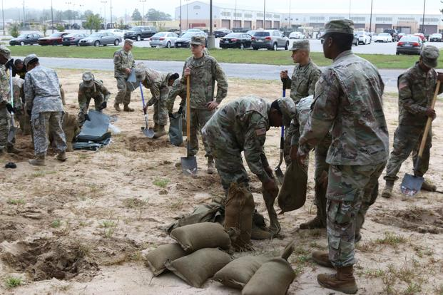3rd Expeditionary Sustainment Command Soldiers fill sandbags in preparation for Hurricane Florence at Fort Bragg, North Carolina, September 12, 2018. (U.S. Army/Staff Sgt. Terrance Payton)