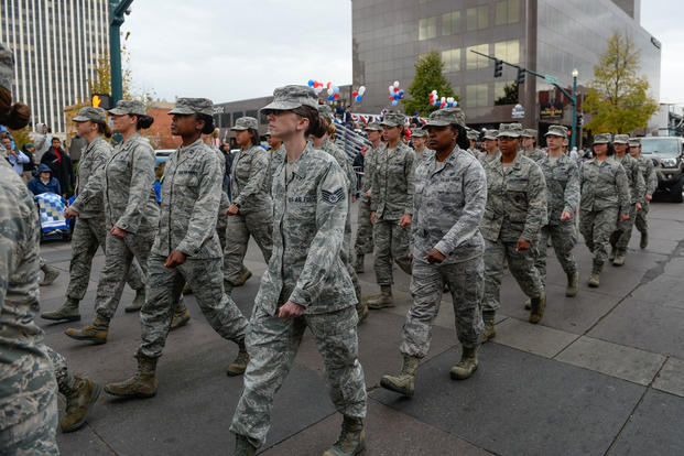 Airmen walk during the Colorado Springs Veterans Day Parade in Colorado Springs, Colorado, Nov. 5, 2016. The all-female Airmen flight represented Schriever during the women in military themed parade. (U.S. Air Force photo/Christopher DeWitt)