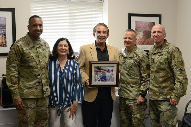 4th Inf. Div. and Fort Carson Deputy Commanding General William L. Thigpen, Evans Army Community Hospital Commander Col. Eric S. Edwards and 4ID Command Sgt. Maj. Frank Handoe meet with Carol and Tony DiRaimondo at the DiRaimondo Family Medicine Clinic Sept. 27, 2018, at Fort Carson, Colorado. The DiRaimondo family presented a picture of their son to the DiRaimondo Family Medicine Clinic.  (U.S. Army/ Jeanine Mezei)