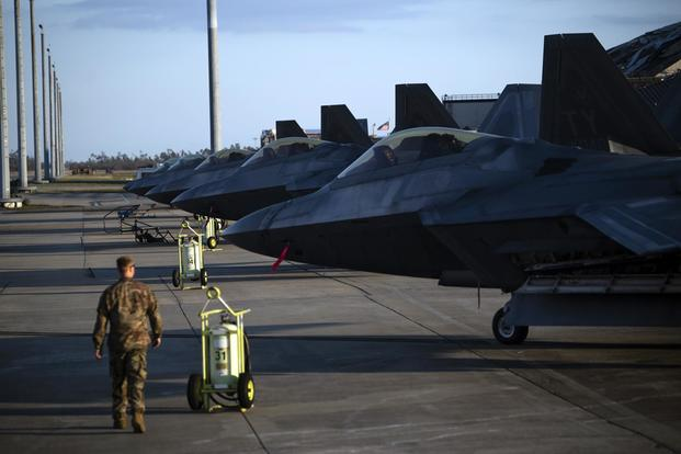 F-22 Raptors are parked near the runway at Tyndall Air Force Base, Florida, Oct. 15, 2018. Air Combat Command has mobilized multiple relief assets in an effort to restore operations after the hurricane caused catastrophic damage to the base. (U.S. Air Force/Master Sgt. Russ Scalf)