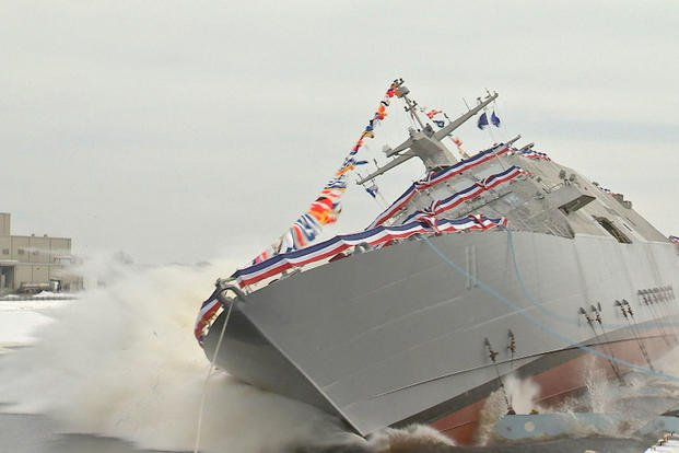 "The future USS Sioux City (LCS 11) is launched into the Menominee River seconds after ship sponsor Mary Winnefeld, wife of retired Adm. James ""Sandy"" Winnefeld, christened the Freedom variant littoral combat ship, Jan. 30, 2016. (U.S. Navy photo by Lockheed)"