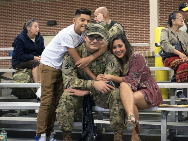 Family embrace their Soldier of 3rd Infantry Division Sustainment Brigade minutes prior to his departure. (U.S. Army/Candace Mundt)