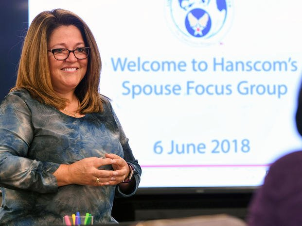 Brandi Ruiz, left, Airman & Family Readiness Center chief, speaks with a spouse during a Key Spouse Orientation Training focus group at the Community Support Center at Hanscom Air Force Base, Mass. (Air Force/Todd Maki)