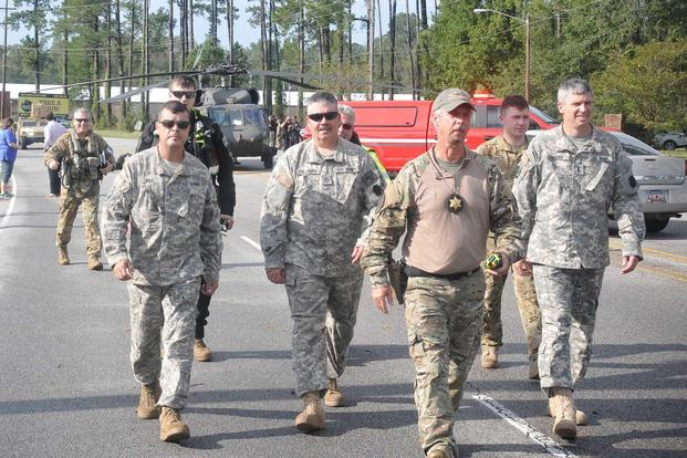 Pennsylvania National Guard members are escorted by emergency responders to the Horry County emergency operations center in Conway, South Carolina, on Sept. 17, 2018, after Hurricane Florence. Pennsylvania National Guardsmen will be the first to see the Army's new mobile pay system roll out. Photo by Capt. Travis Mueller/Pennsylvania National Guard