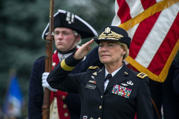 U.S. Army Gen. Ann E. Dunwoody, former commanding general of the Army Materiel Command, salutes during the playing of the national anthem at her retirement ceremony on Joint Base Myer-Henderson Hall, Va., Aug. 15, 2012. (U.S. Army photo/Teddy Wade)