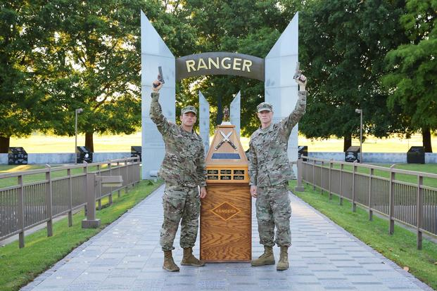 FORT BENNING, Ga. -- From left, Capts. Michael Rose and John Bergman of the 101st Airborne Division pose at the Ranger Monument April 15, 2019 at Fort Benning, Georgia. (U.S. Army/Markeith Horace, Maneuver Center of Excellence, Fort Benning Public Affairs)