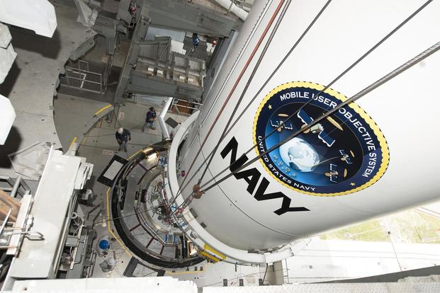 The U.S. Navy's fourth Mobile User Objective System satellite, encapsulated in a 5-meter payload fairing, is mated to an Atlas V booster inside the Vertical Integration Facility at Cape Canaveral, Aug. 19, 2015) (Photo courtesy United Launch Alliance)