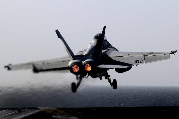 An F/A-18F Super Hornet assigned to Strike Fighter Squadron (VFA) 22 launches from the Nimitz-class aircraft carrier USS Carl Vinson (CVN 70) on March 8, 2011. (U.S. Navy photo by Mass Communication Specialist Seaman Nicolas C. Lopez)