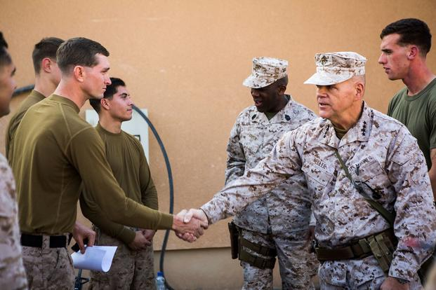 FILE -- In Dec. 21, 2015 file photo, U.S. Marine Gen. Robert B. Neller, 37th commandant of the Marine Corps, and Sgt. Maj. Ronald Green, 18th Sergeant Major of the Marine Corps, visit Marines with with 1st Battalion, 7th Marine Regiment, Special Purpose Marine Air Ground Task Force - Crisis Response - Central Command at Al Asad Air Base, Iraq. During their visit to the U.S. Central Command area of responsibility, the leaders addressed Marines and sailors on matters concerning the future of the Corps and wis