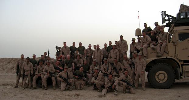 FILE -- In in this Jan. 1, 2004 file photo, Marine Sgt. Charlie Brown (seated on the truck third from right), a Data Network Specialist with 2nd Marine Logistics Group (Forward), deployed to Iraq with the Marines of Weapons Platoon, Kilo Company, 3rd Battalion, 1st Marine Regiment, who took time to pose for a photo during their 2005 deployment in Iraq. Brown is currently serving in Afghanistan on his sixth deployment. ( Katherine Solano/U.S. Marine Corps)