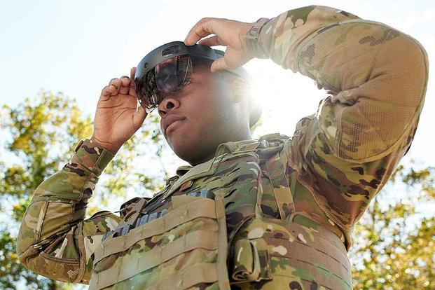 A soldier tries on a prototype of the Army's Integrated Visual Augmentation System (IVAS) during a soldier touch point evaluation that began at Fort Pickett, Virginia, on Oct. 28, 2019. U.S. Army Futures Command photo