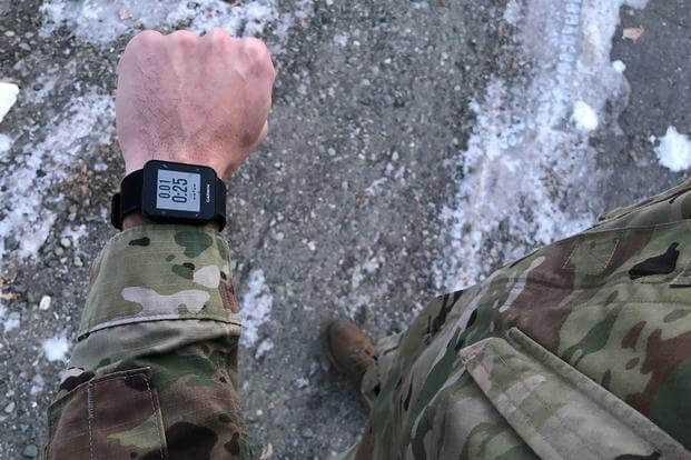A soldier uses a fitness tracker