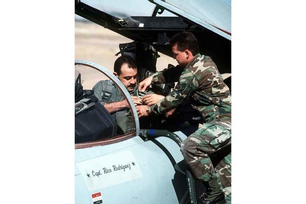 "Cesar ""Rico"" Rodriguez straps into his F-15 Thunderbird."