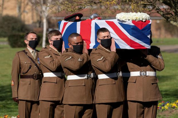 The coffin of Captain Sir Tom Moore is carried by members of the Armed Forces during his funeral.