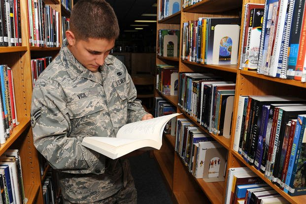 Senior airman looks through college exam book