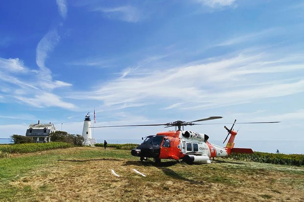 Coast Guard MH-60 Jayhawk helicopter near Wood Island Lighthouse in Saco Bay, Maine