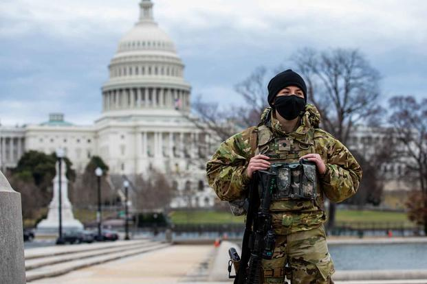 A military police officer secures an area near the U.S. Capitol.