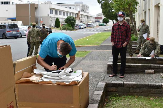 NAVSUP Fleet Logistics Center Yokosuka household goods team assists sailors.