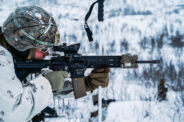 Marine fires M27 infantry automatic rifle Setermoen, Norway