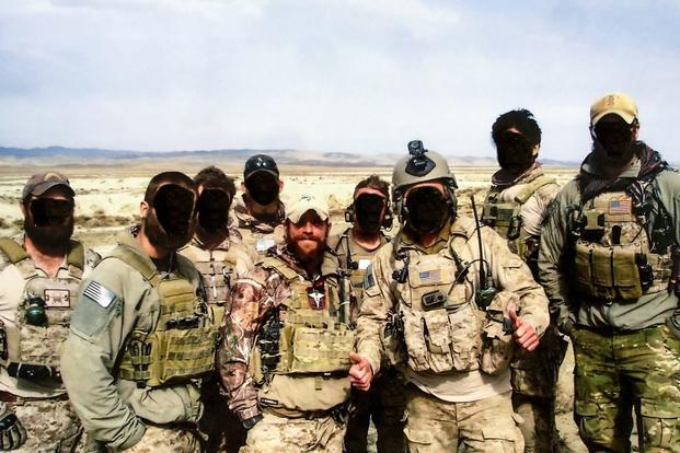 Navy SEAL Eddie Gallagher and team members on deployment.