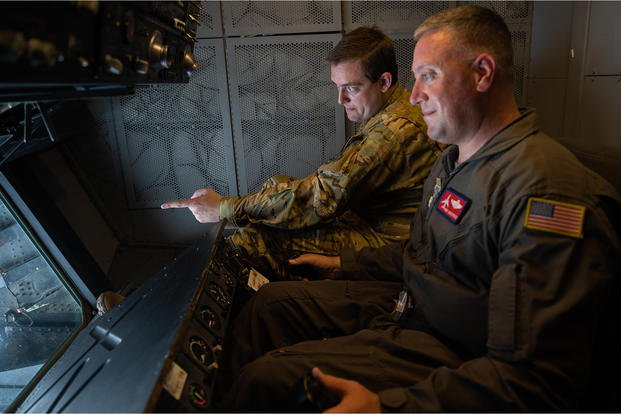 An in-flight refueler/instructor goes to work.