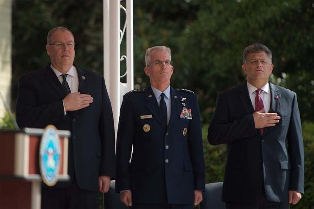 From left, Deputy Defense Secretary Bob Work, Air Force Gen. Paul J. Selva and Michael L. Rhodes honor the flag during a ceremony at the Pentagon marking the 15th anniversary of 9/11, Sept. 9, 2016. (DoD photo by Army Sgt. Amber)