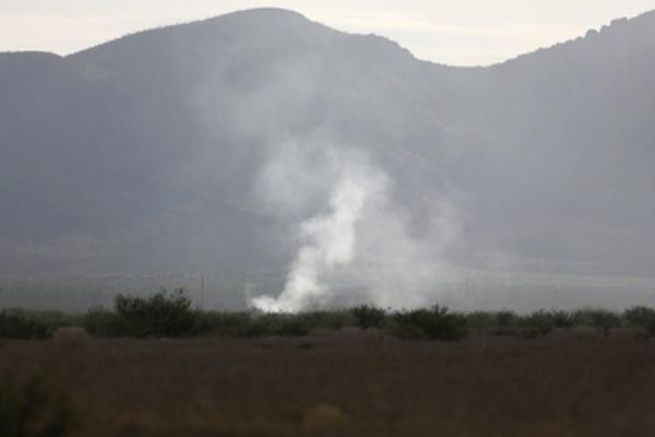 Smoke rises from an F-16 Fighting Falcon that crashed Thursday June 25, 2015, during a training exercise with the 162nd wing Arizona Air National Guard north of Douglas, Arizona. (Mamta Popat / Arizona Daily Star via The Associated Press.)