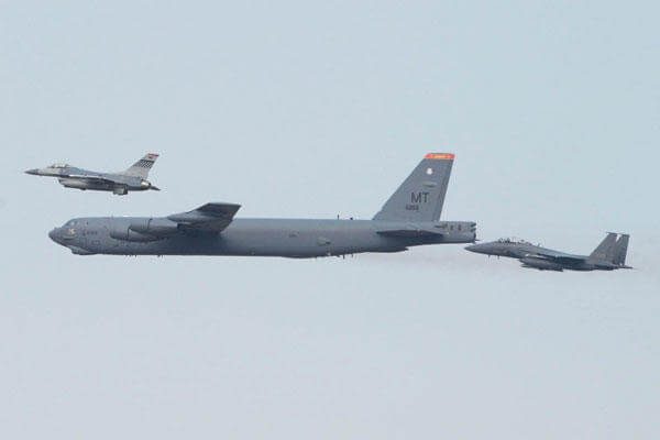 A US B-52 bomber, joined by South Korean F-15 and US F-16 fighters, flew low over Osan, South Korea, in response to a recent nuclear test by North Korea. (Courtesy US Pacific Command)