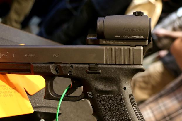 Raven Concealment has a new mount for attaching an Aimpoint Micro T1 or H1 red-dot sight on a Glock or other semi-auto pistols. (Photo by Matthew Cox/Military.com)