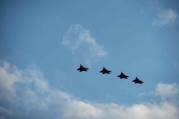 U.S. Air Force F-22 Raptor fighter aircraft pilots assigned to the 95th Fighter Squadron at Tyndall Air Force Base, Fla., fly in formation Aug. 28, 2015, over Spangdahlem Air Base, Germany. (Photo by Christopher Ruano/U.S. Air Force)