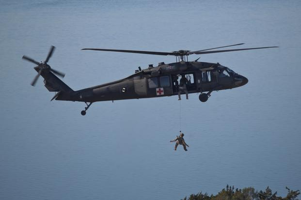 A UH-60 Black Hawk helicopter hoists a tactical air control party airman during a training exercise in New Jersey on Nov. 18, 2016. (U.S. Air National Guard photo/Matt Hecht)