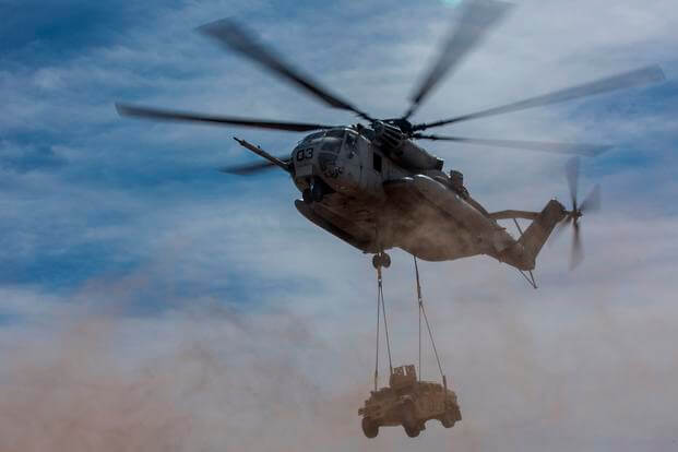 A U.S. Marine Corps CH-53E Super Stallion lifts a Humvee during a CH-53 tactics exercise at Auxiliary Airfield 2, Yuma, Ariz., April 7, 2017. (U.S. Marine Corps photo/Michaela R. Gregory)