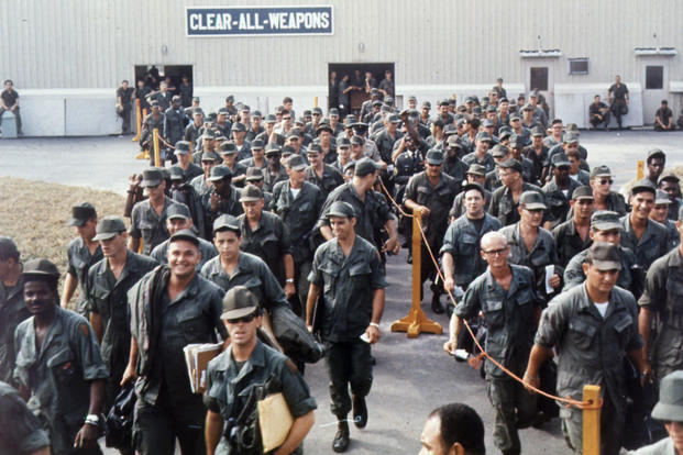 Bien Hoa, Vietnam. Personnel destined to return to the U.S., wait at the Bien Hoa Air Terminal for a National Airlines flight home. 15 February 1968 (Photo: National Archives)