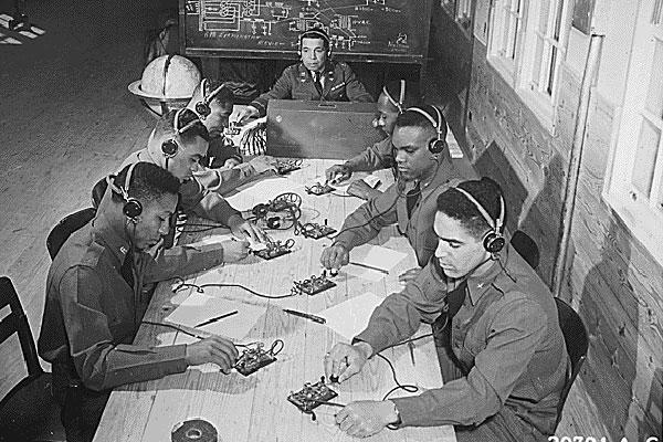 Capt. Roy F. Morse teaches the 99th Pursuit Squadron how to send and receive code. (National Archives)
